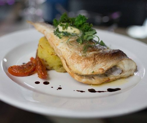 Oven-baked gurnard, garlic & parsley crushed potatoes and lemon butter